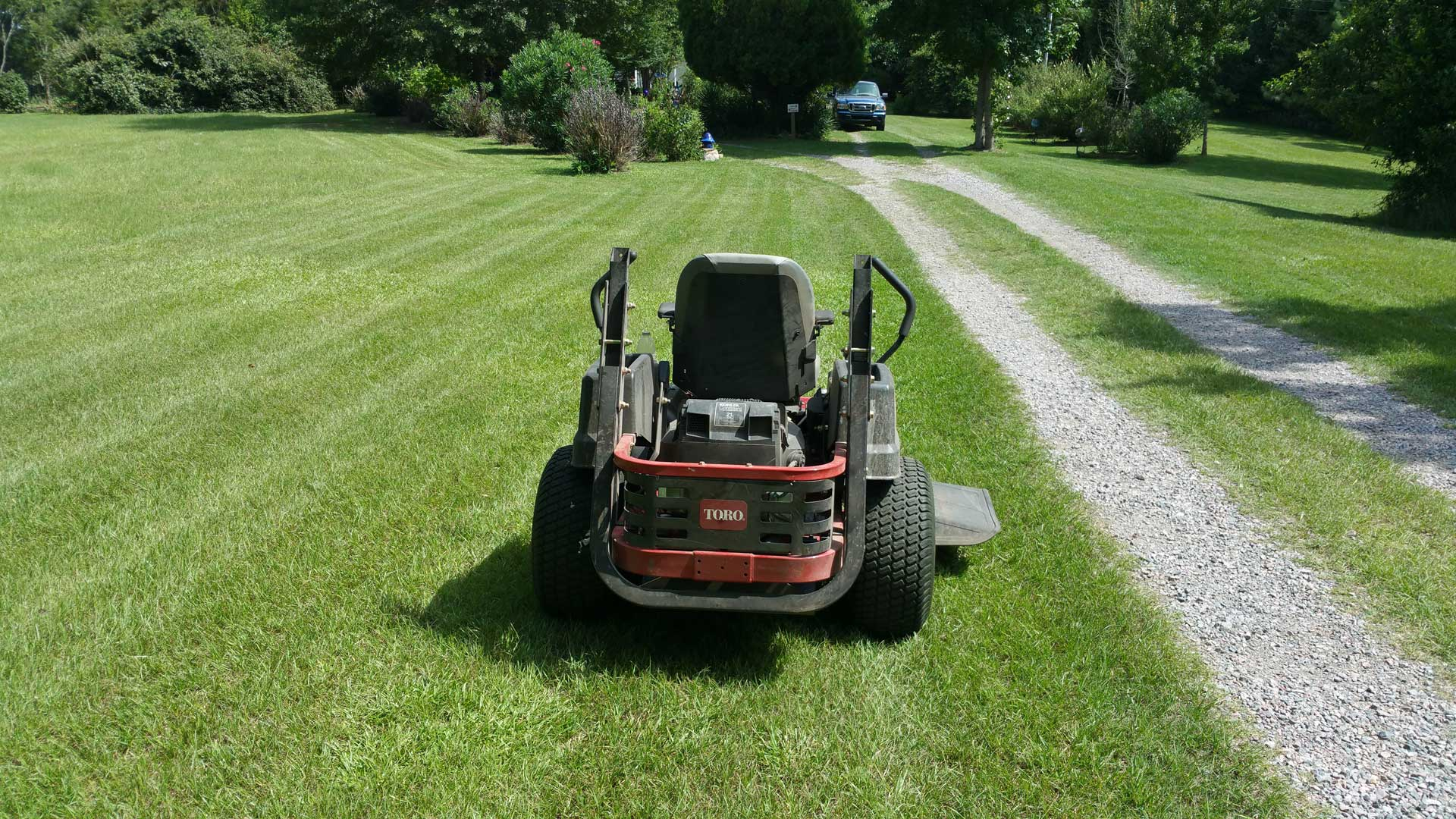QuickCall Services lawn mower at a residential property in Martinez.