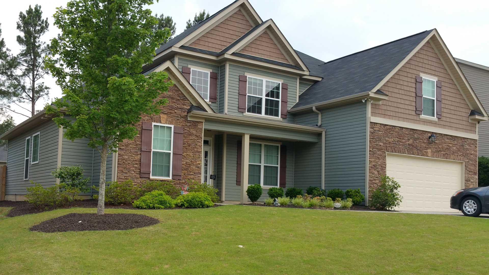 Recently completed lawn and landscape maintenance at a residential property in Evans.
