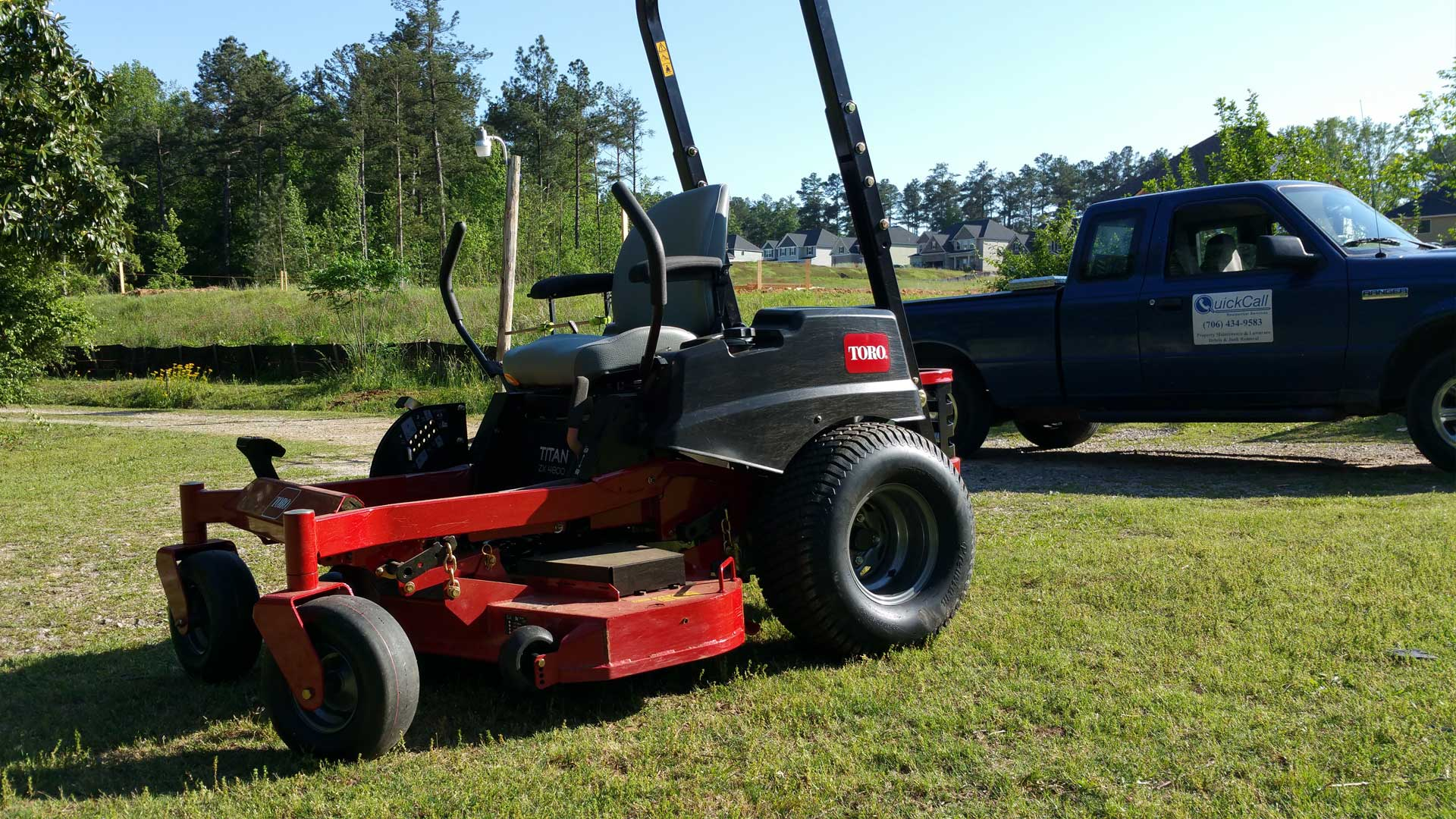 Quick Call lawn mower and truck, contact us today for lawn and landscape maintenance in Martinez.